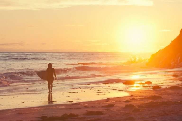 female surfer at sunset in Encinitas California