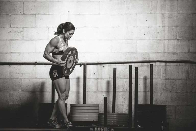 portrait of CrossFit Masters Champion Shellie Edington moving weight plates.