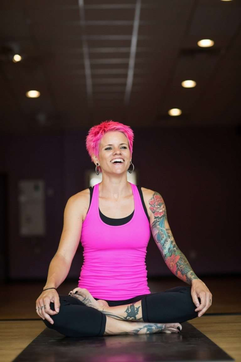 portrait of a woman smiling and practicing yoga