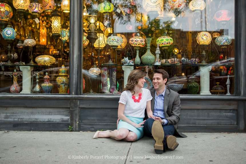 Short North Arts District, Columbus Ohio engagement photography, couple sitting in front of a boutique shop