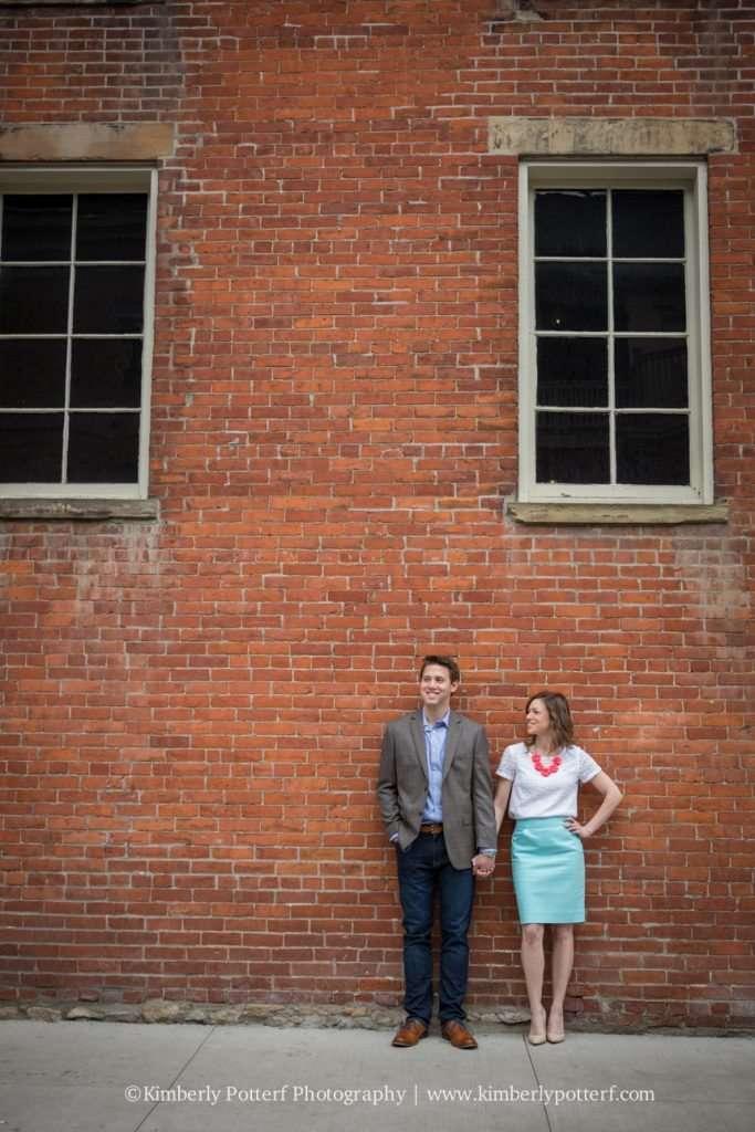Short North Arts District, Columbus Ohio engagement photography, urban setting, brick wall