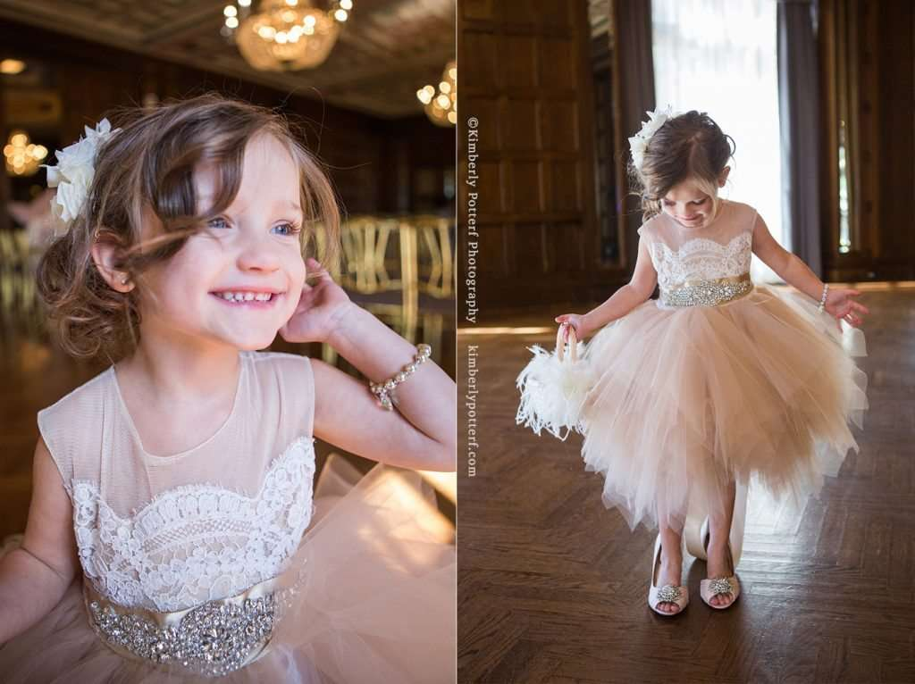 Flower girl wearing a blush and gold dress at the Athletic Club of Columbus