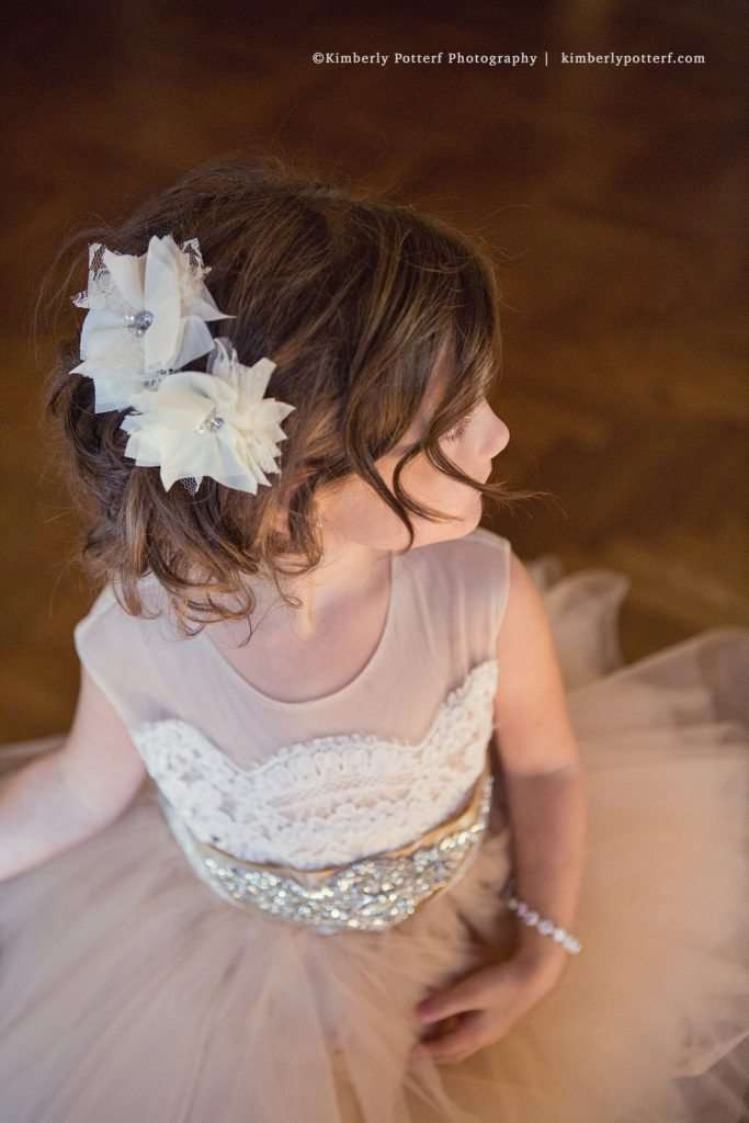 flowergirl at a wedding at the Athletic Club of Columbus, detail shot of her tulle and lace hair clips