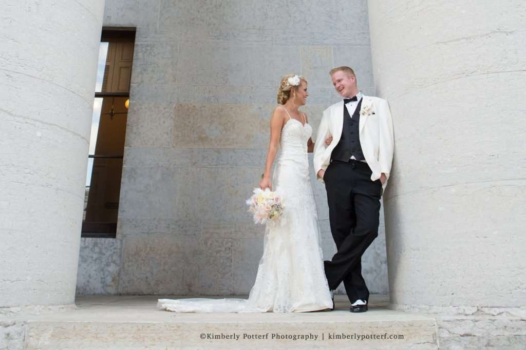 Bride and groom laughing and posing for portraits at the Ohio Statehouse