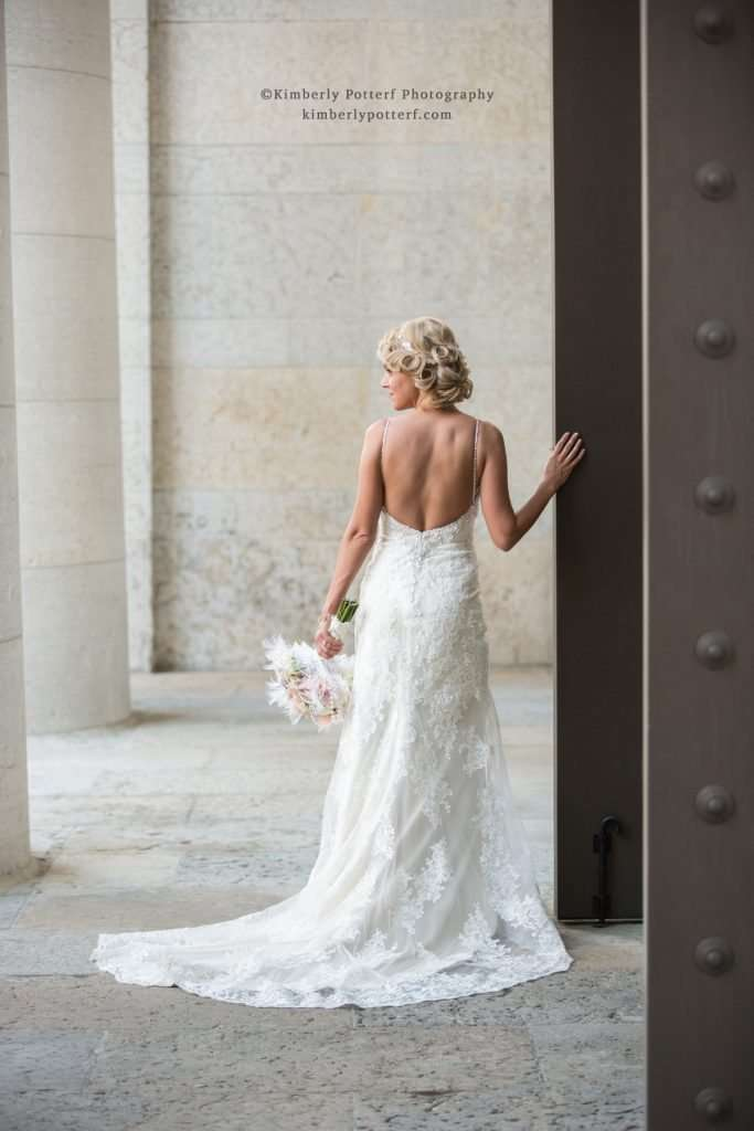 classic portrait of a bride in a low back wedding dress at the Ohio Statehouse