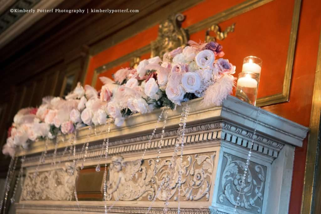 floral ceremony decor on the fireplace mantle in the ballroom at the Athletic Club of Columbus