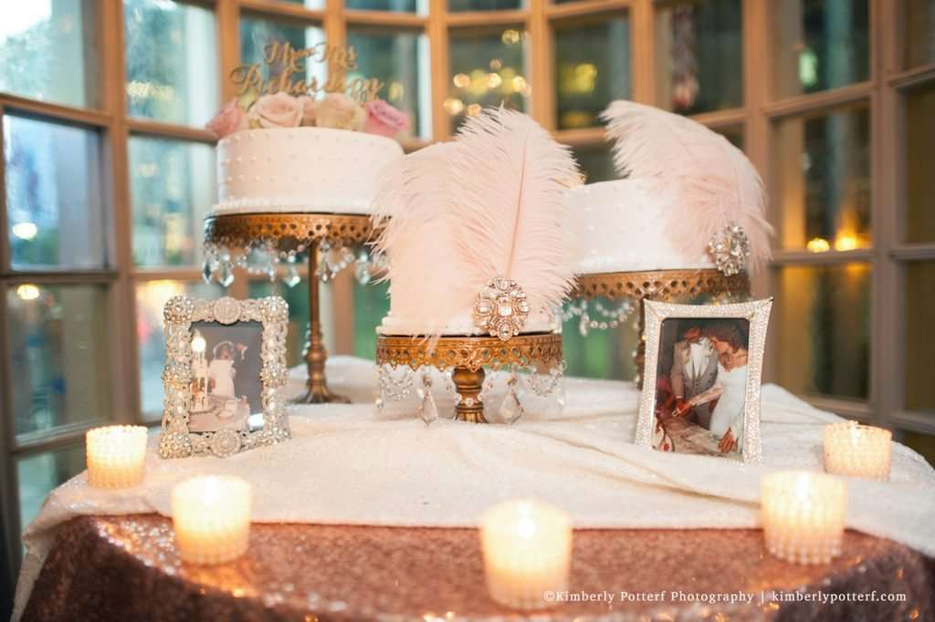 Elegant cake table display at the Athletic Club of Columbus, rose gold sequin table cloth