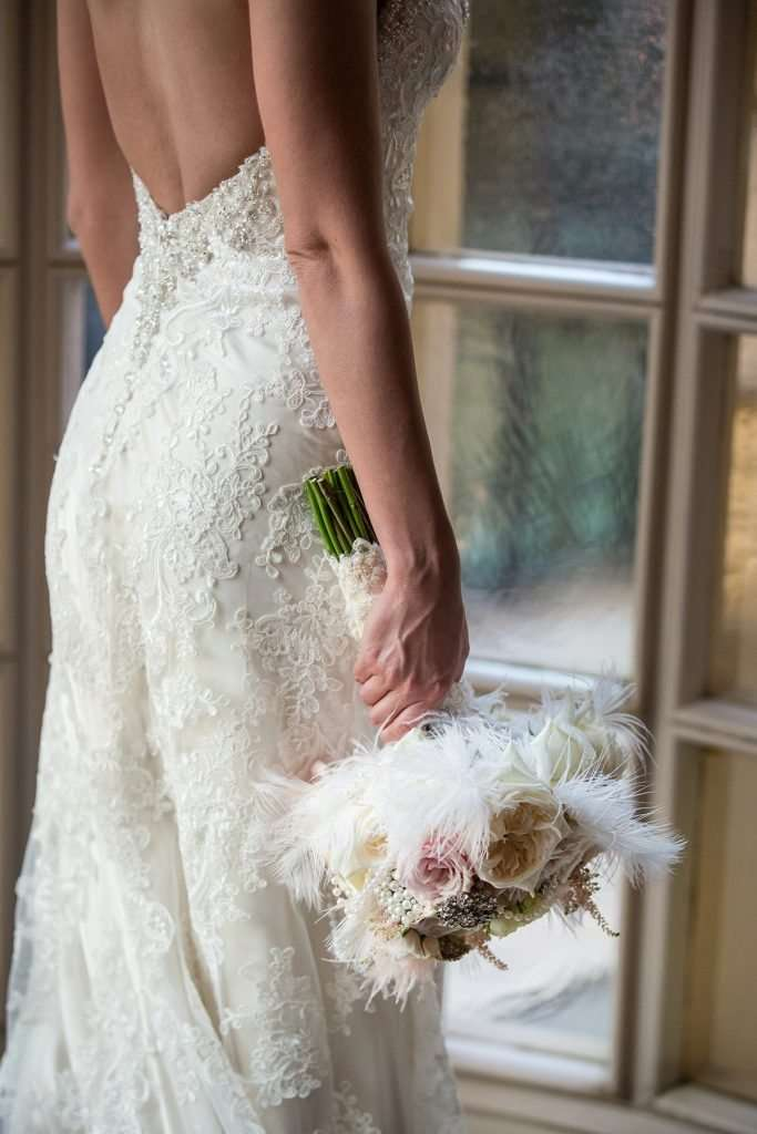 dramatic photo of close up detail on the back of a bridal gown