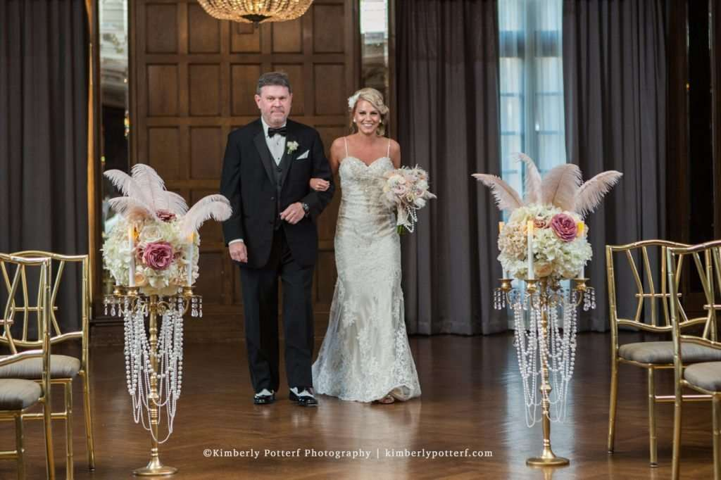 Bride and her father walking down the aisle during a wedding ceremony at the Athletic Club of Columbus