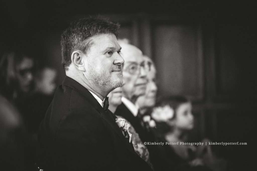 Father of the bride watching the wedding ceremony