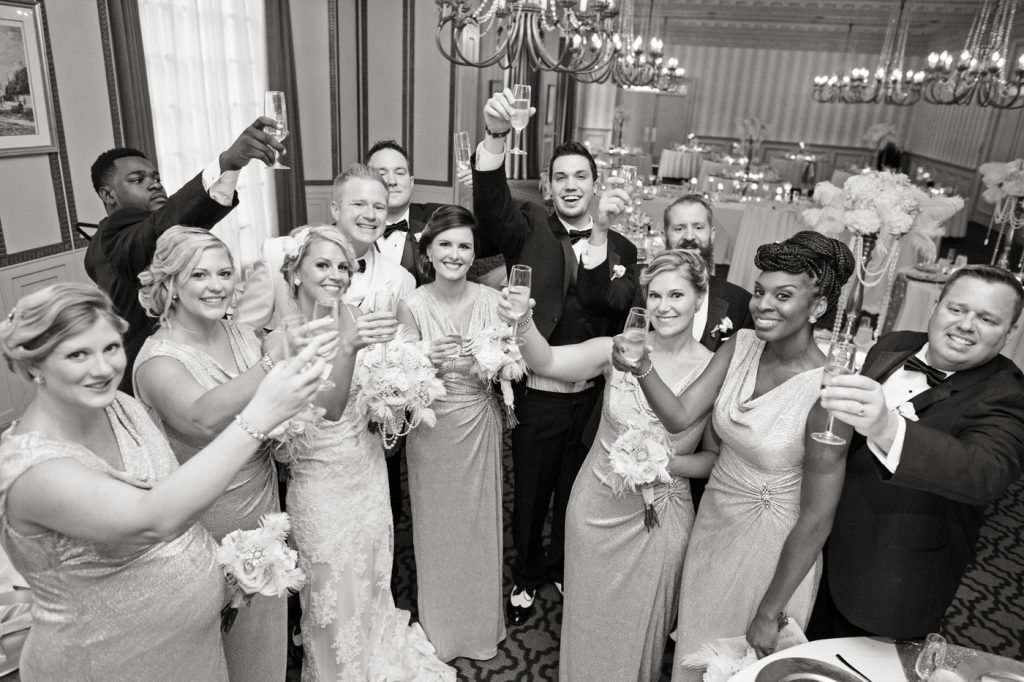 bridal party in a congratulatory toast after the wedding ceremony at the Athletic Club of Columbus