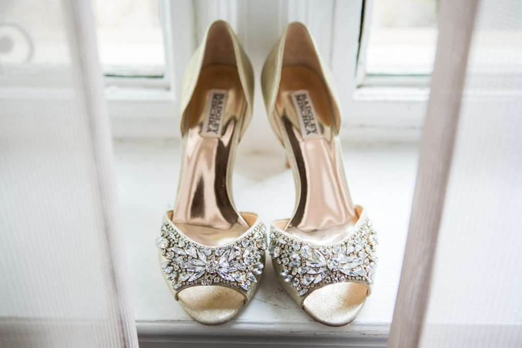 Badgley Mischka rhinestone bridal shoes sitting in a window sill