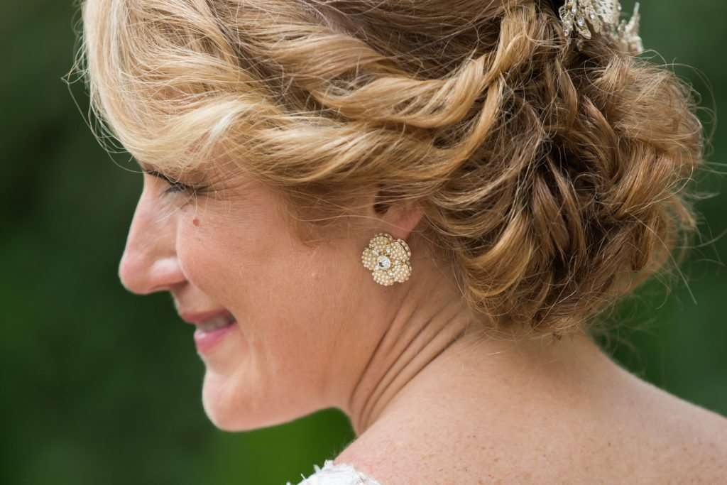 profile shot of a bride wearing Kate Spade earrings