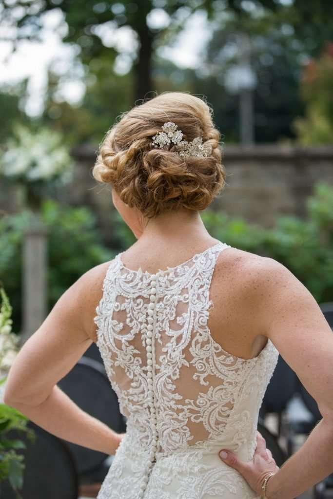 Bride wearing a lace wedding gown with an open back