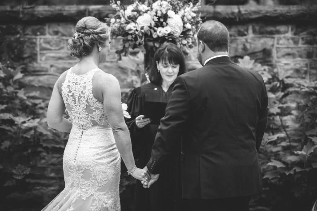 black and white photograph of bride and groom during their wedding ceremony at the Granville Inn