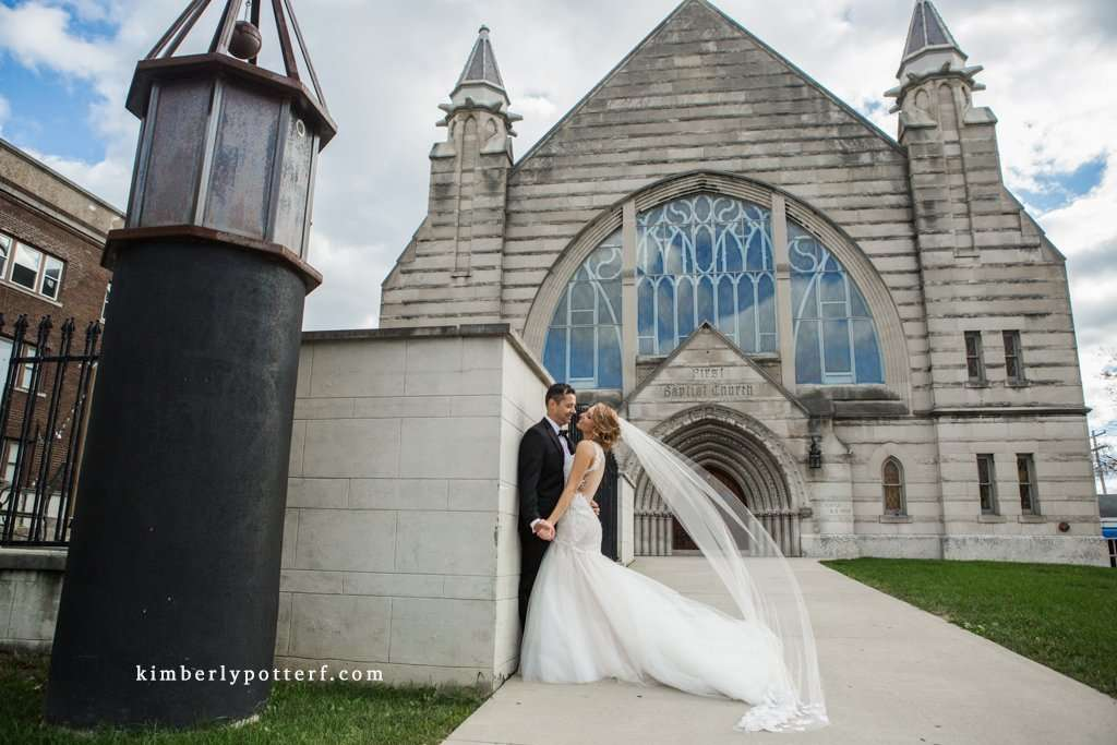 Wide angle image of a bride and groom in front of the Bluestone event venue