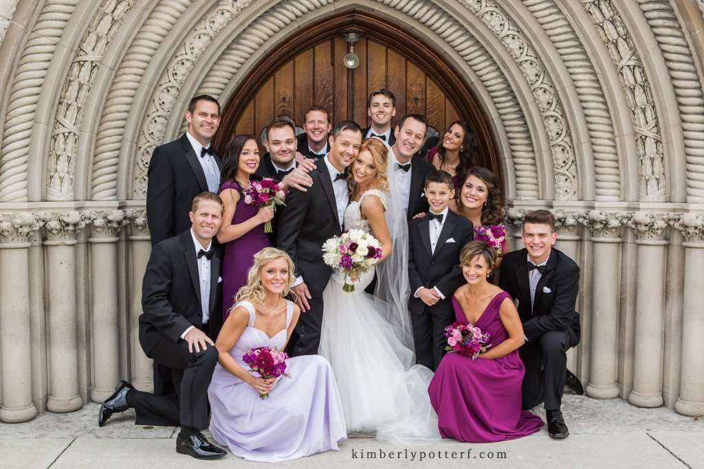 Fun casual group shot of a bridal party in front of the Bluestone event venue