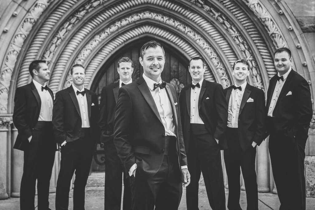 Groomsmen wearing classic black tuxedos in front of the Bluestone event venue