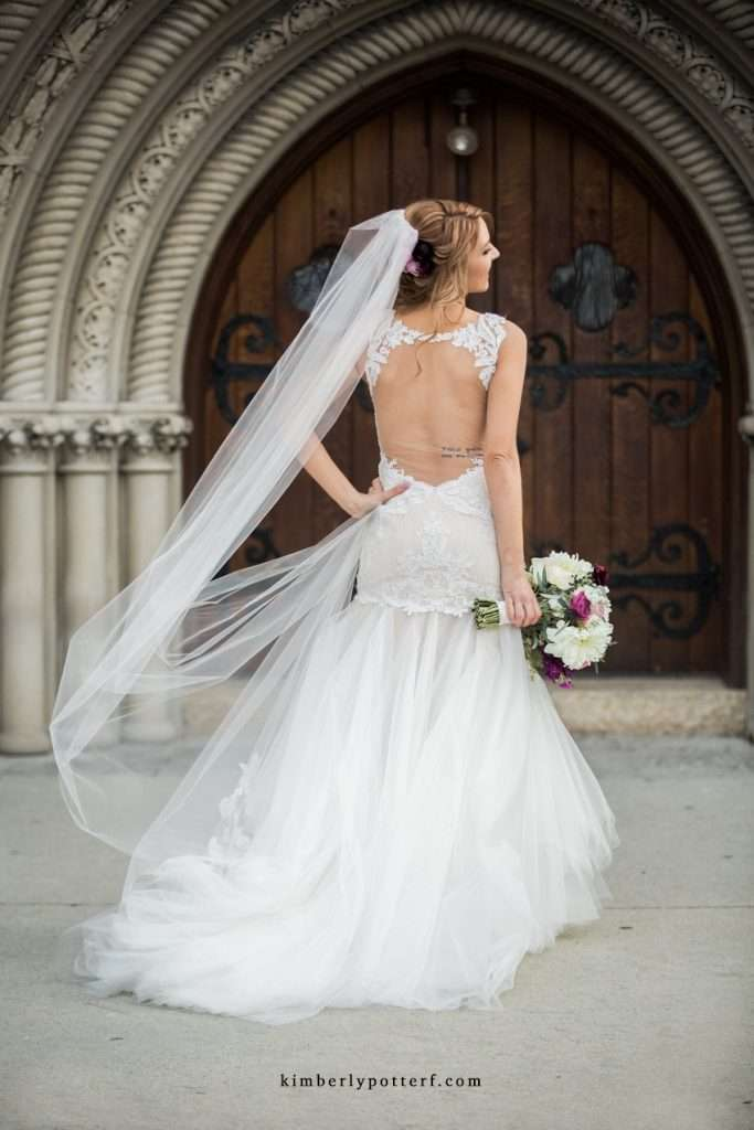 Rear view shot of a bride wearing the Wtoo backless wedding dress Giselle