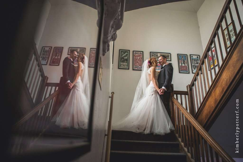 dramatic and romantic portrait of a bride and groom on the steps inside the Bluestone with their reflection