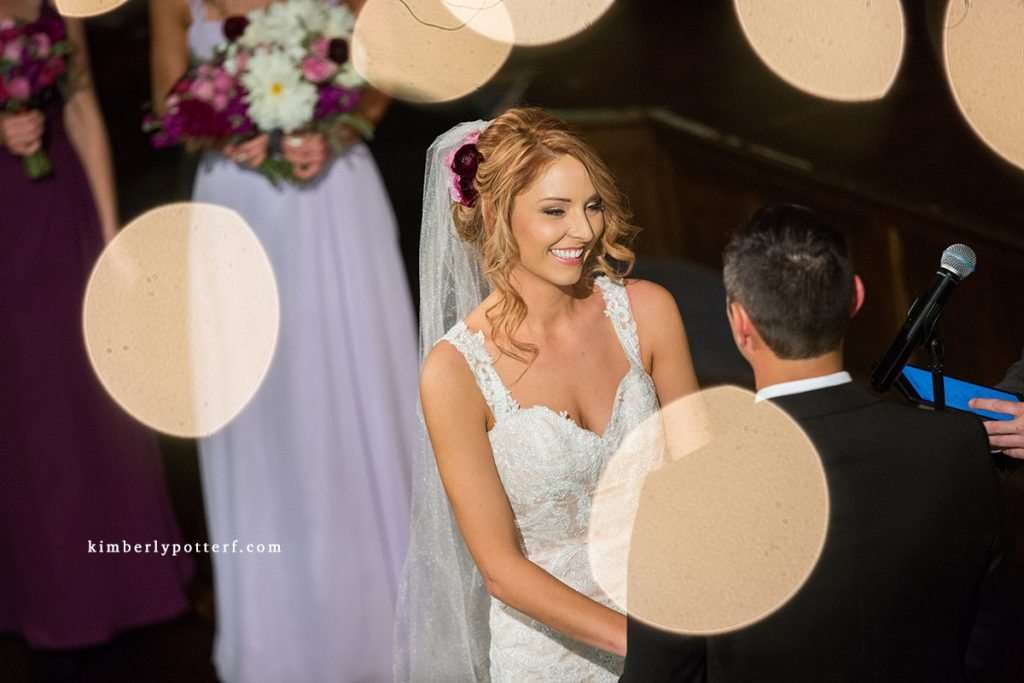 close-up shot of a bride's happy expression during her wedding ceremony at the Bluestone event venue