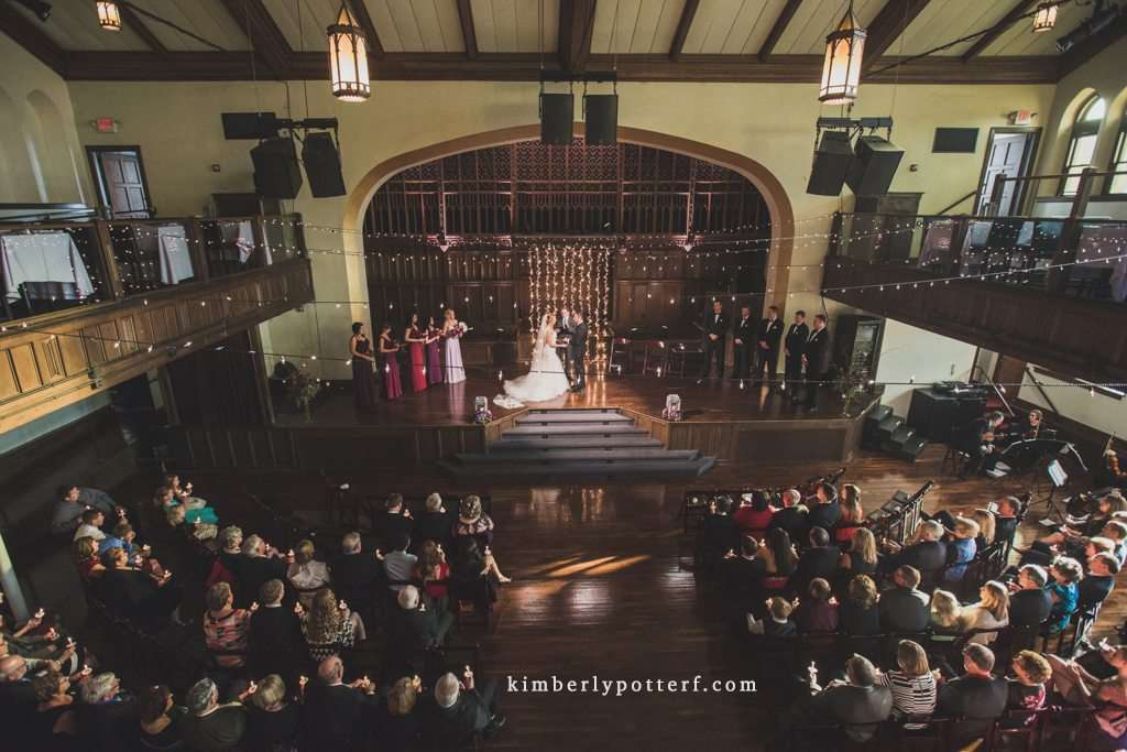 dramatic wide angle image of a wedding ceremony at the Bluestone event venue in Columbus Ohio