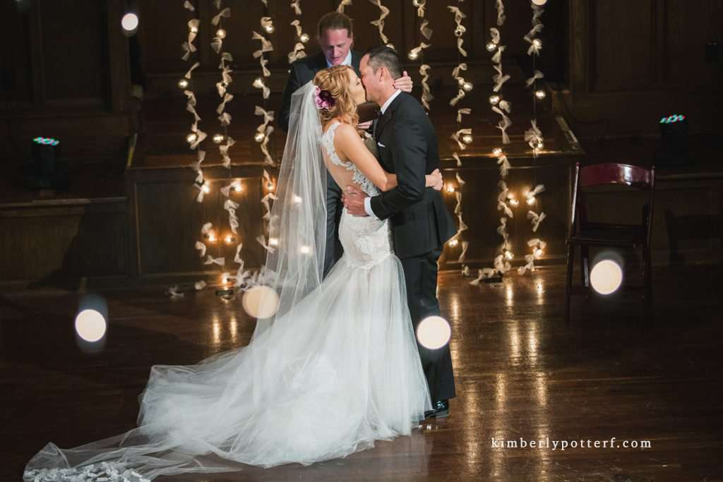 bride and groom exchanging their first kiss during their ceremony at the Bluestone event venue