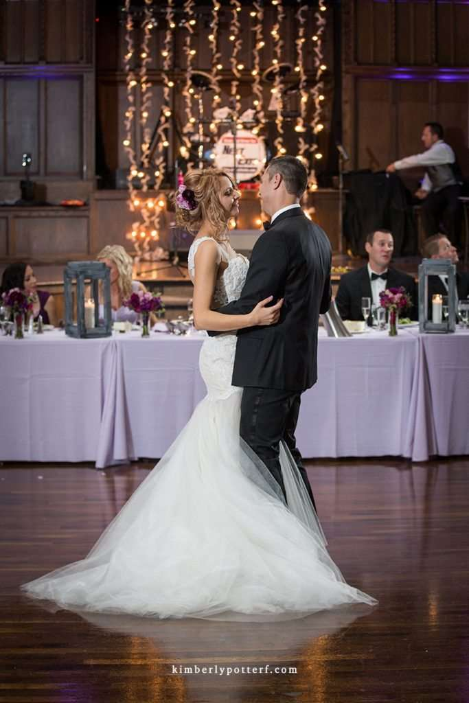 bride and groom sharing their first dance with a backdrop of twinkling lights at the Bluestone wedding and event venue