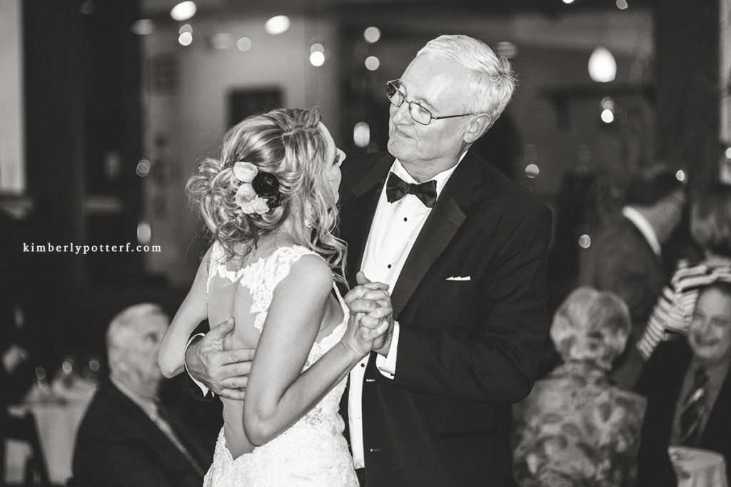father daughter dance during a wedding reception