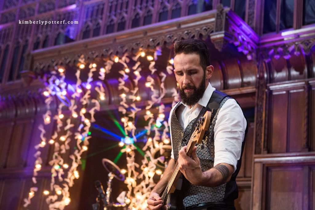 close-up shot of a guitar player at a wedding reception