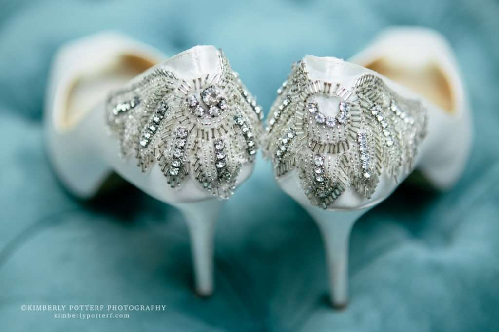 fancy rhinestone bridal shoes on a light blue velvet backdrop