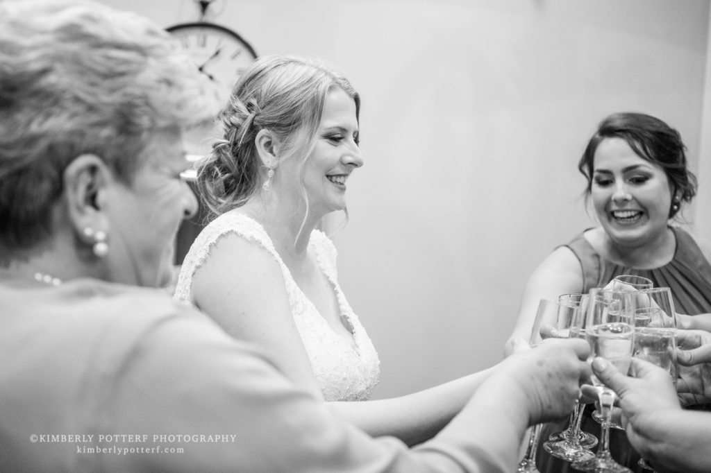 bride toasting with her bridesmaids on her wedding day