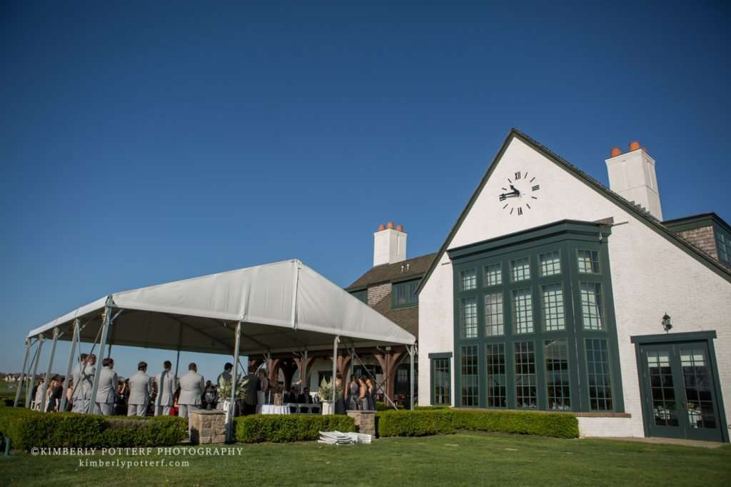 wide angle shot of an outdoor wedding ceremony at the Golf Club of Dublin on a bright sunny day