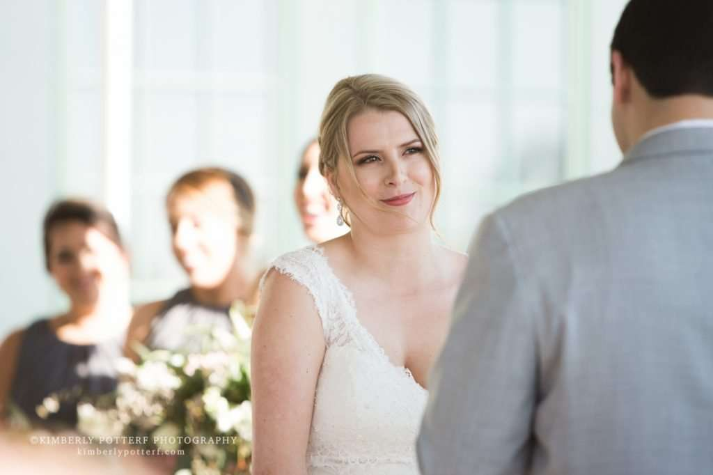 a bride smiling looking at her husband during an outdoor wedding ceremony at the Golf Club of Dublin