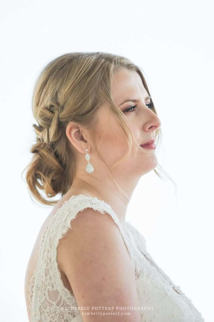 a candid profile shot of a bride against a bright white background