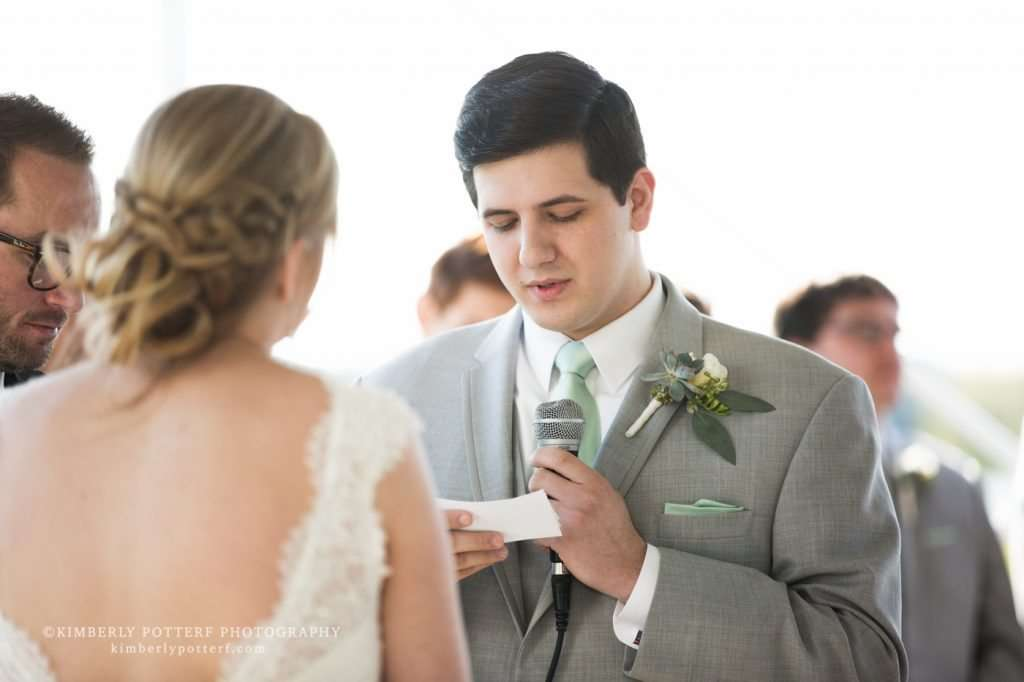 a groom saying his vows during a wedding ceremony