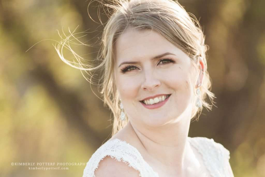 close up portrait of a bride at sunset with wisps of hair blowing