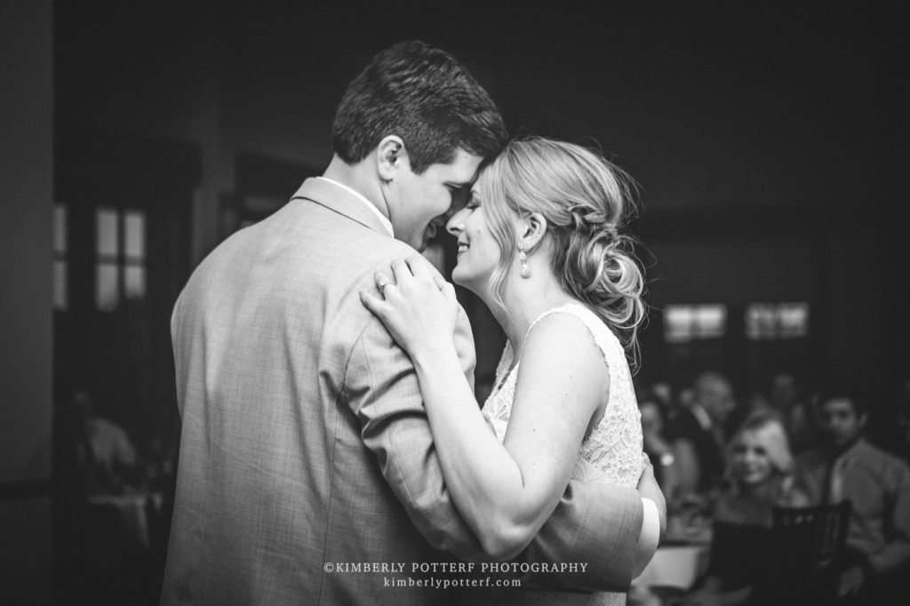 dramatic black and white image of a bride and groom sharing their first dance