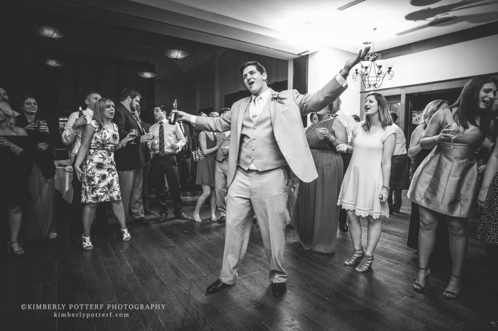 the groom dancing and having fun at a wedding reception