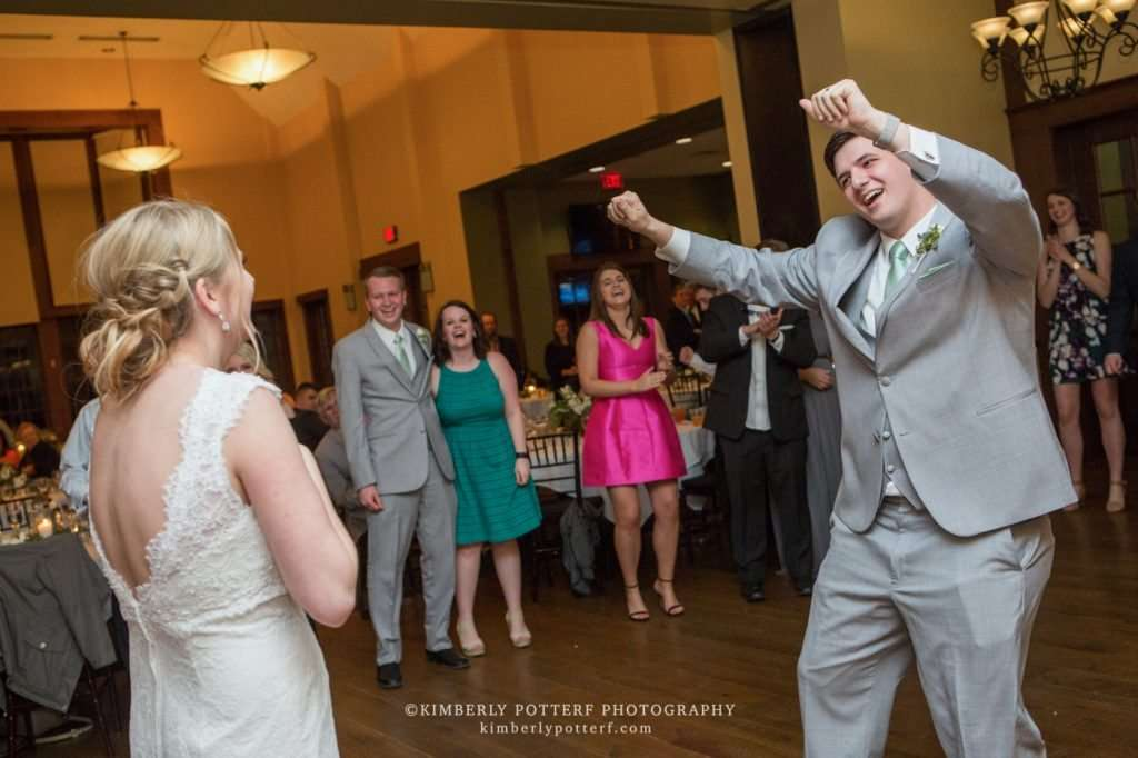 groom dancing and making his bride laugh during their wedding reception