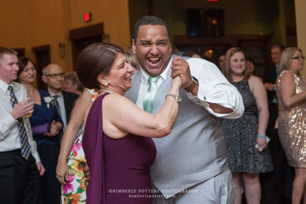 guests at a wedding laughing and dancing