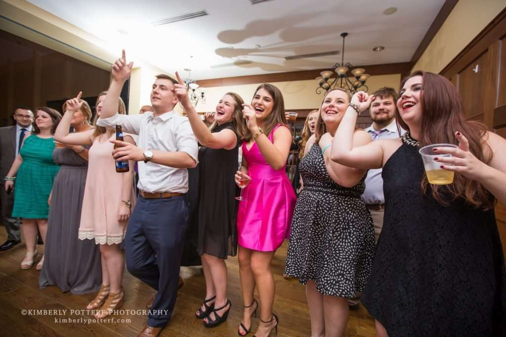 guests at a wedding reception laughing and dancing
