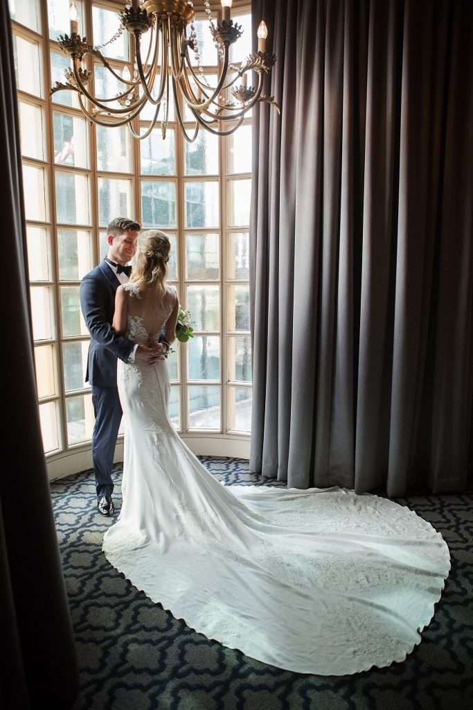 bride and groom in a dramatic window at the Athletic Club of Columbus