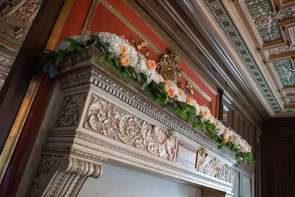 close-up image of ornate detail and floral garland on a fireplace at the Athletic Club of Columbus
