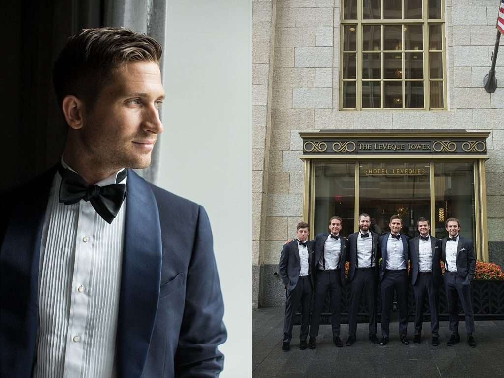 a group of groomsmen posing for a photo in front of the Hotel Leveque