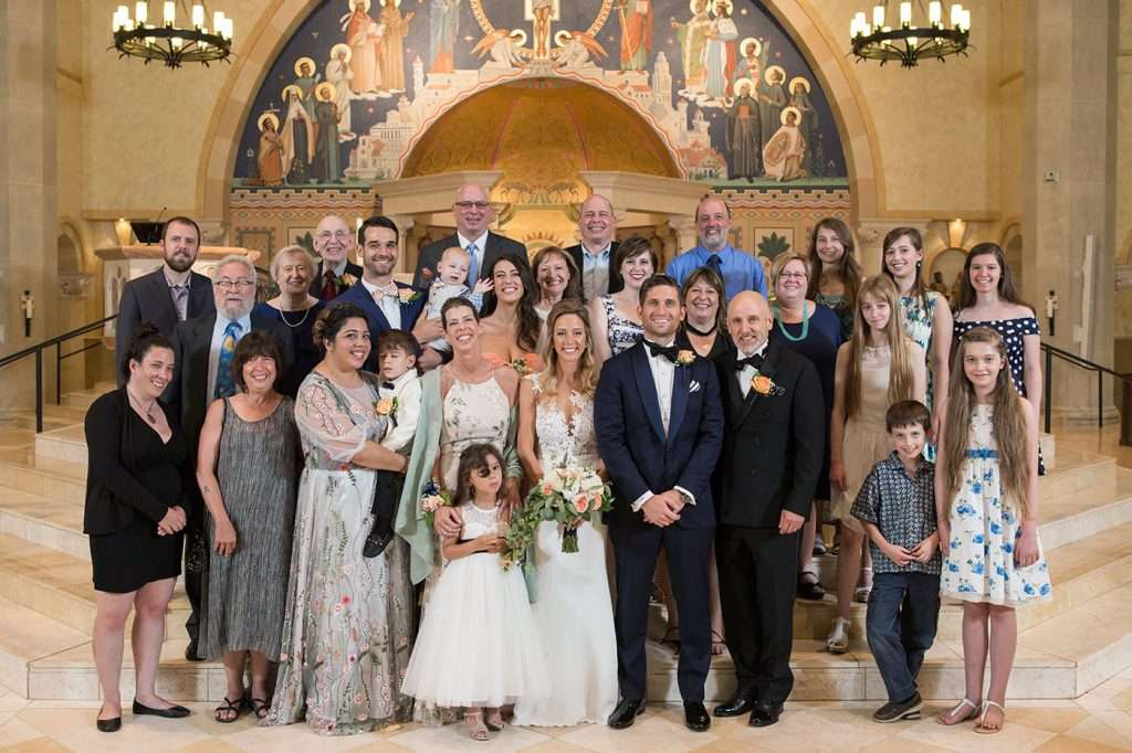 formal portrait of a large extended family inside a Catholic Church
