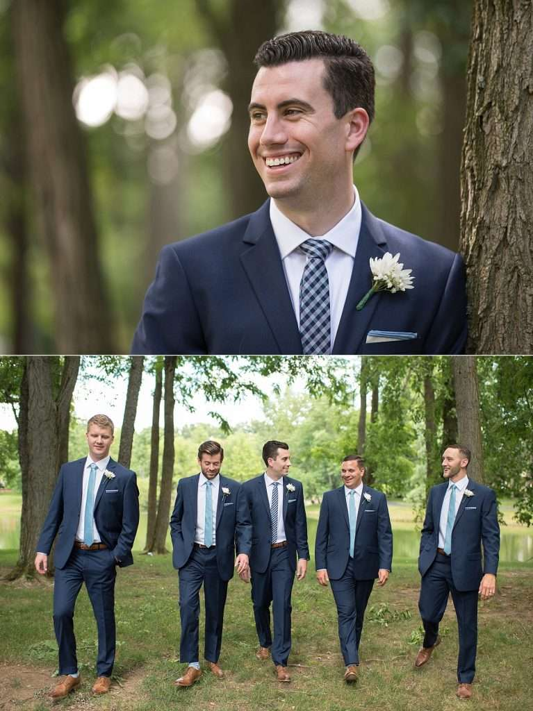groomsmen wearing dark blue suites and light blue ties with white bouttinieres