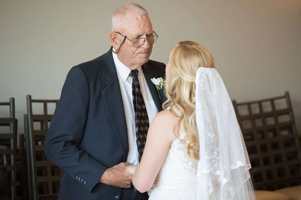 bride talking to her grandfather