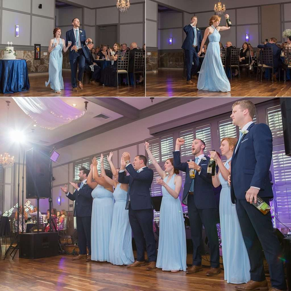 bridesmaids and groomsmen wearing blue dresses and suits cheering and celebrating at the wedding reception