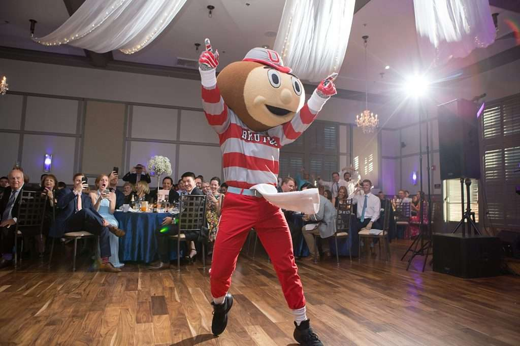 Brutus the Buckeye mascot dancing at a wedding reception